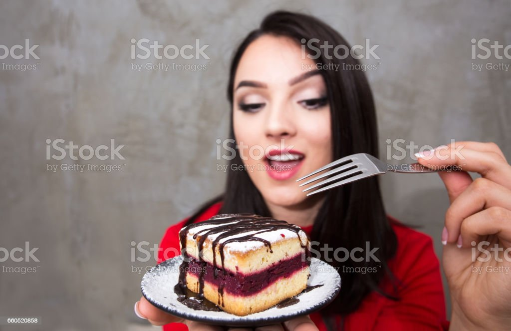 Woman eat Unhealthy or sweet  food stock photo