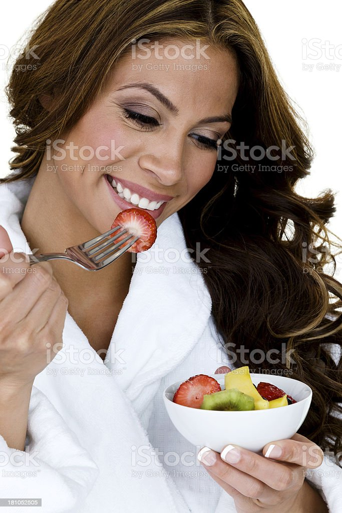 Woman eating a fruit salad royalty-free stock photo