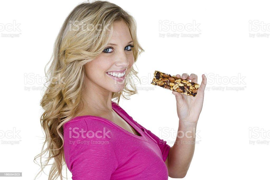 Woman eating a health bar royalty-free stock photo
