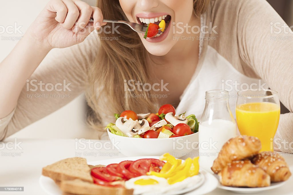 Woman eating a healthy meal. royalty-free stock photo
