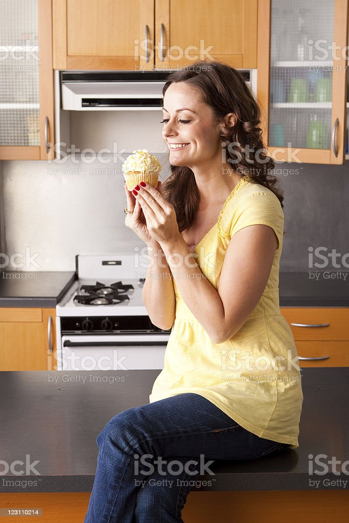 Woman eating a muffin royalty-free stock photo