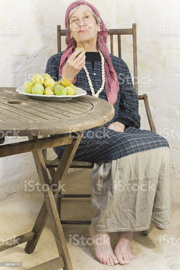 Woman Eating a Plum stock photo