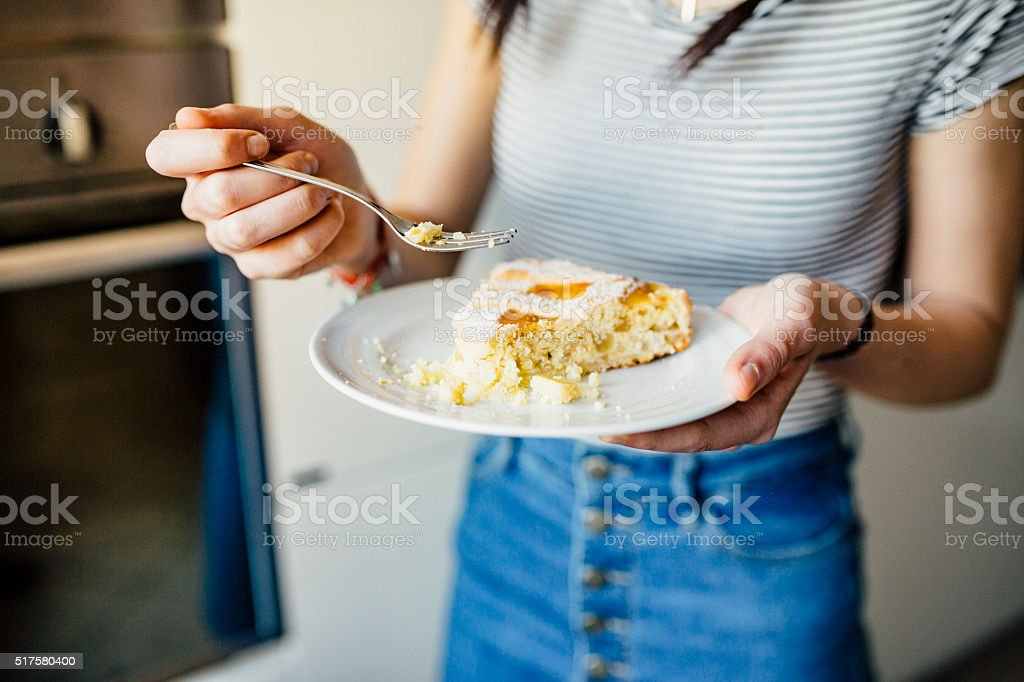 Woman Eating a Slice of Neapolitan Pastiera Pie stock photo