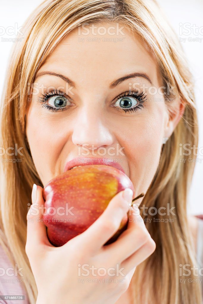 Woman eating an apple. royalty-free stock photo