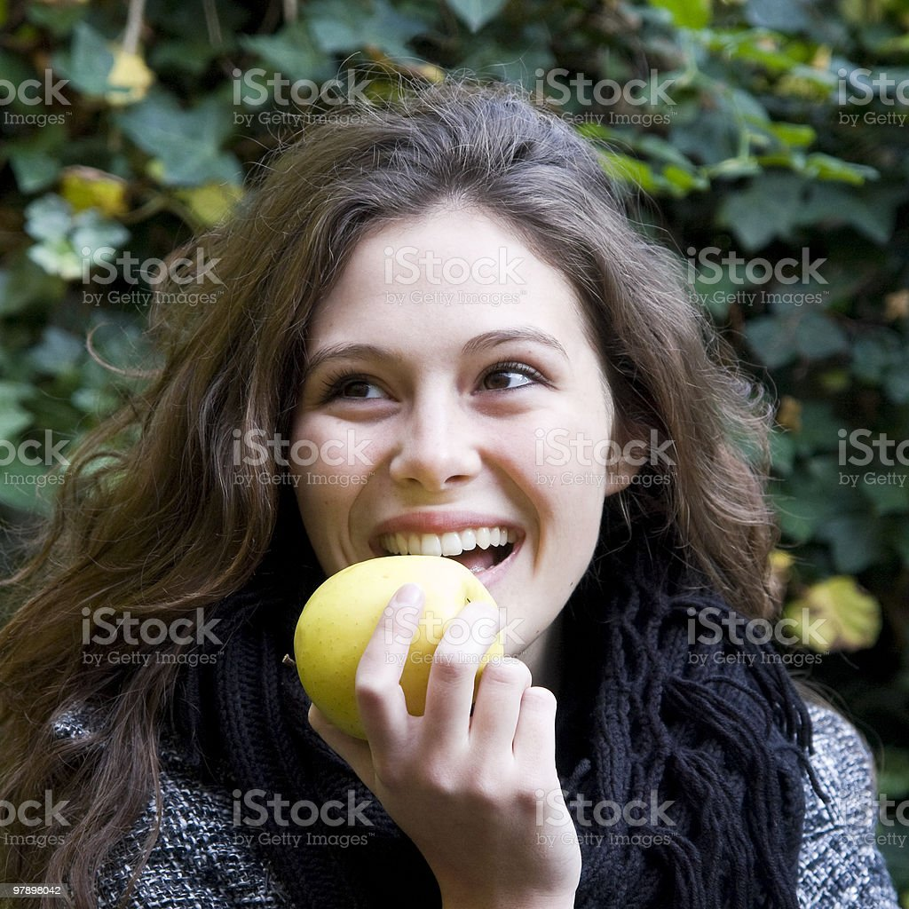 Woman eating an apple royalty-free stock photo