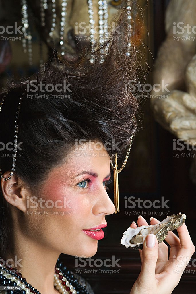 Woman eating an oyster royalty-free stock photo