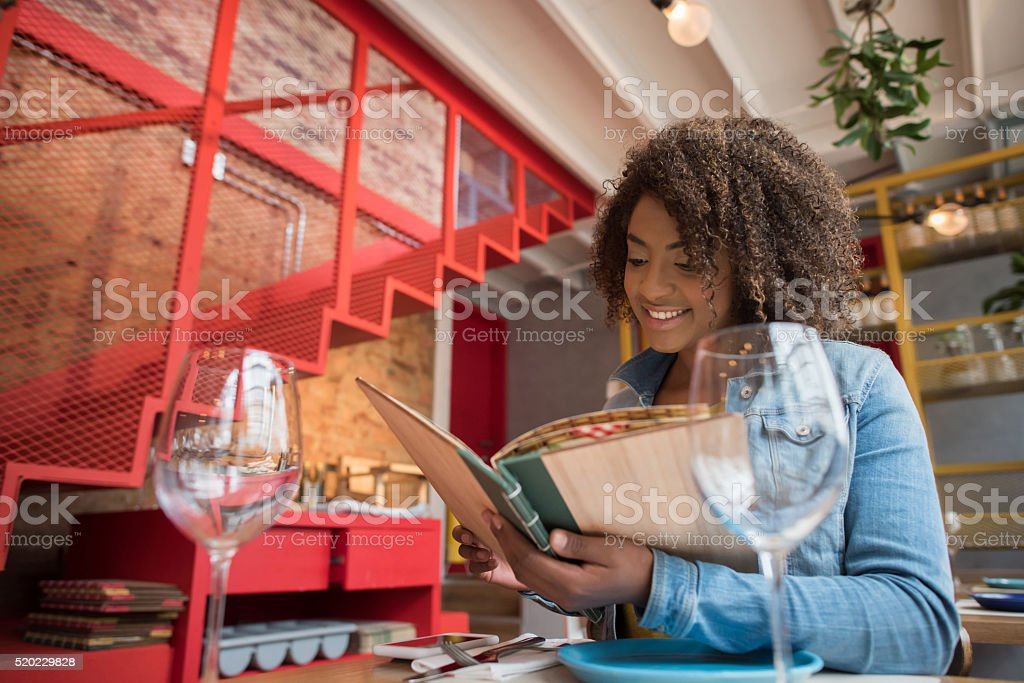 Woman eating at a restaurant stock photo