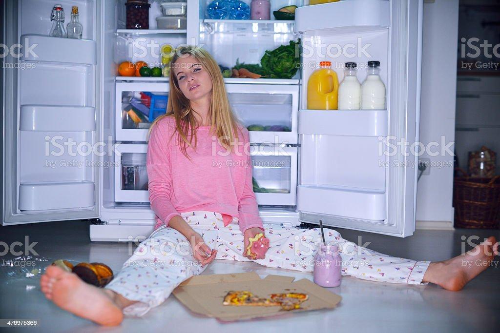 Woman eating at night stock photo