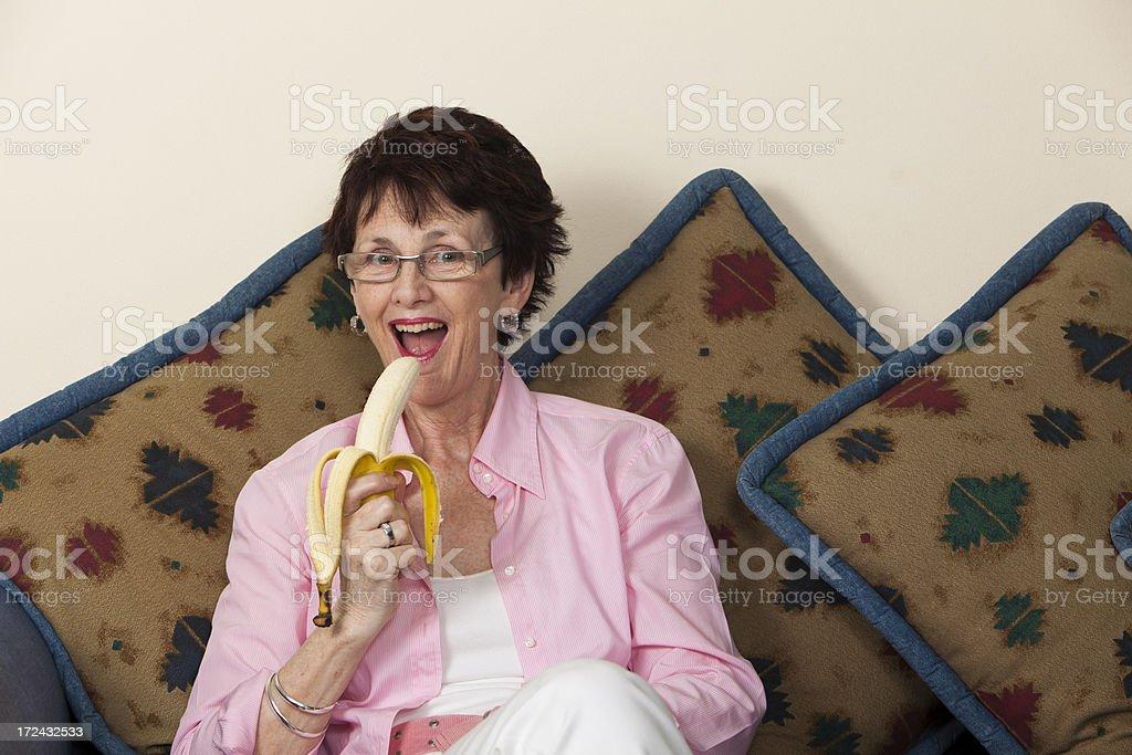 Woman Eating Banana royalty-free stock photo