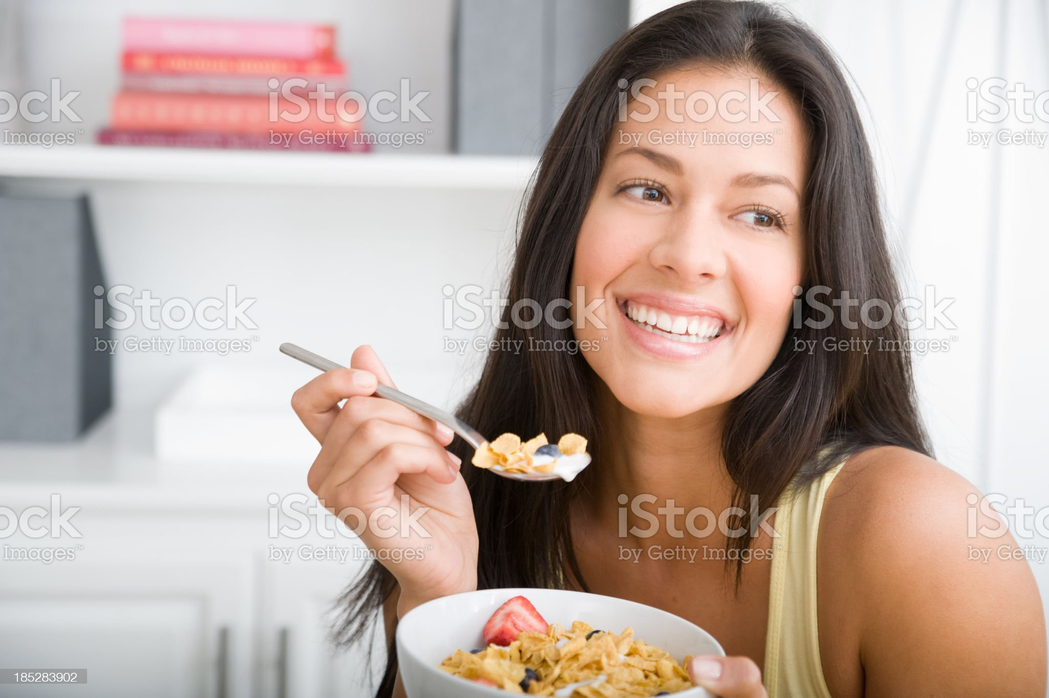 Woman eating breakfast royalty-free stock photo