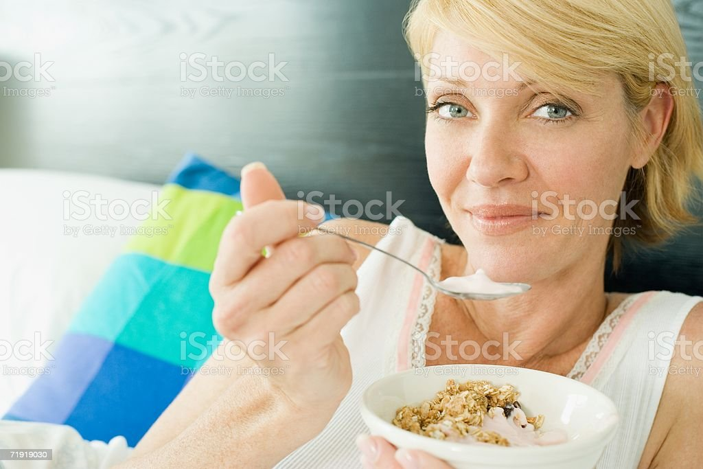 A woman eating breakfast stock photo