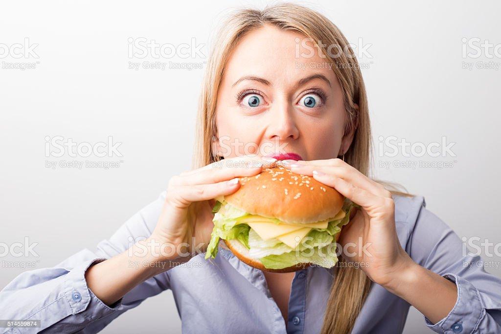 Woman eating burger stock photo