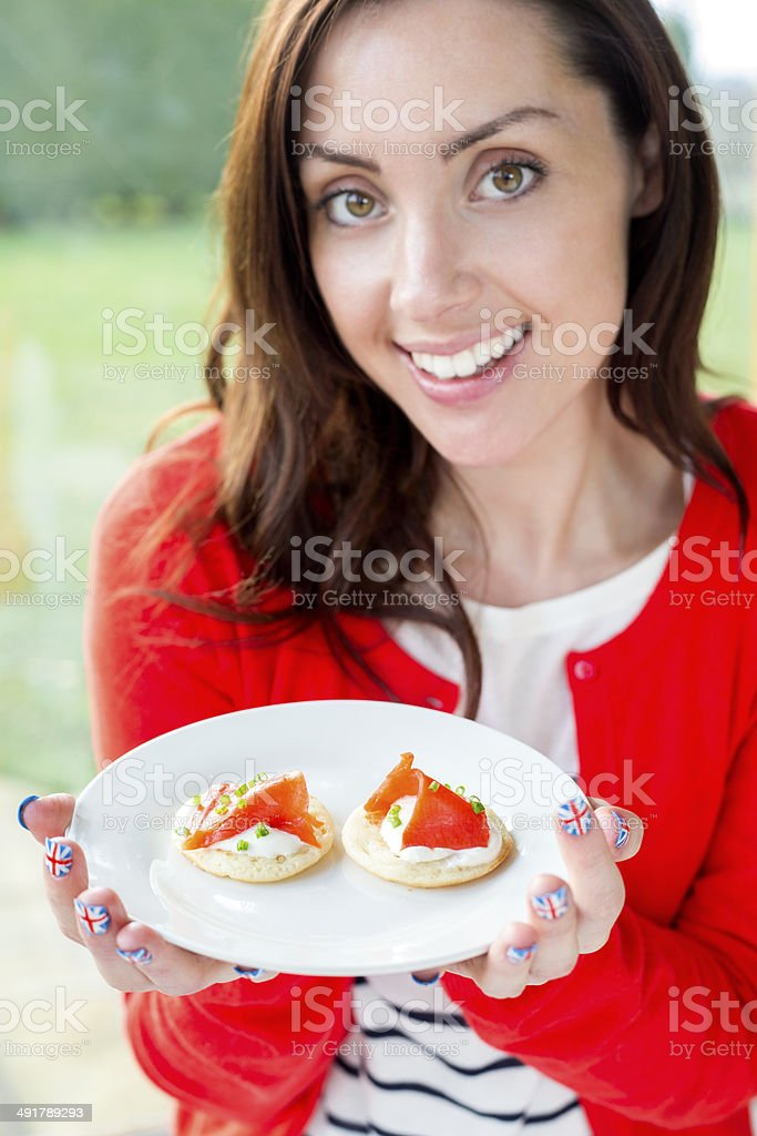 Woman Eating Canapes stock photo