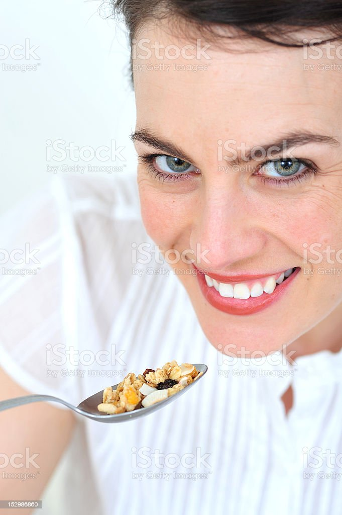 Woman eating cereals stock photo