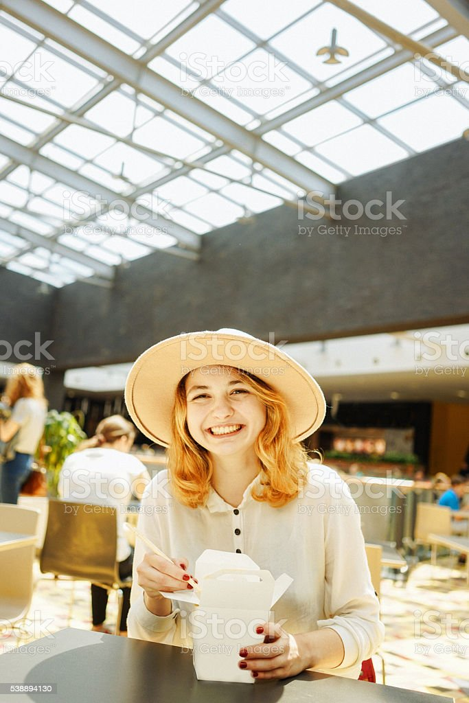 Woman eating Chinese take out food stock photo