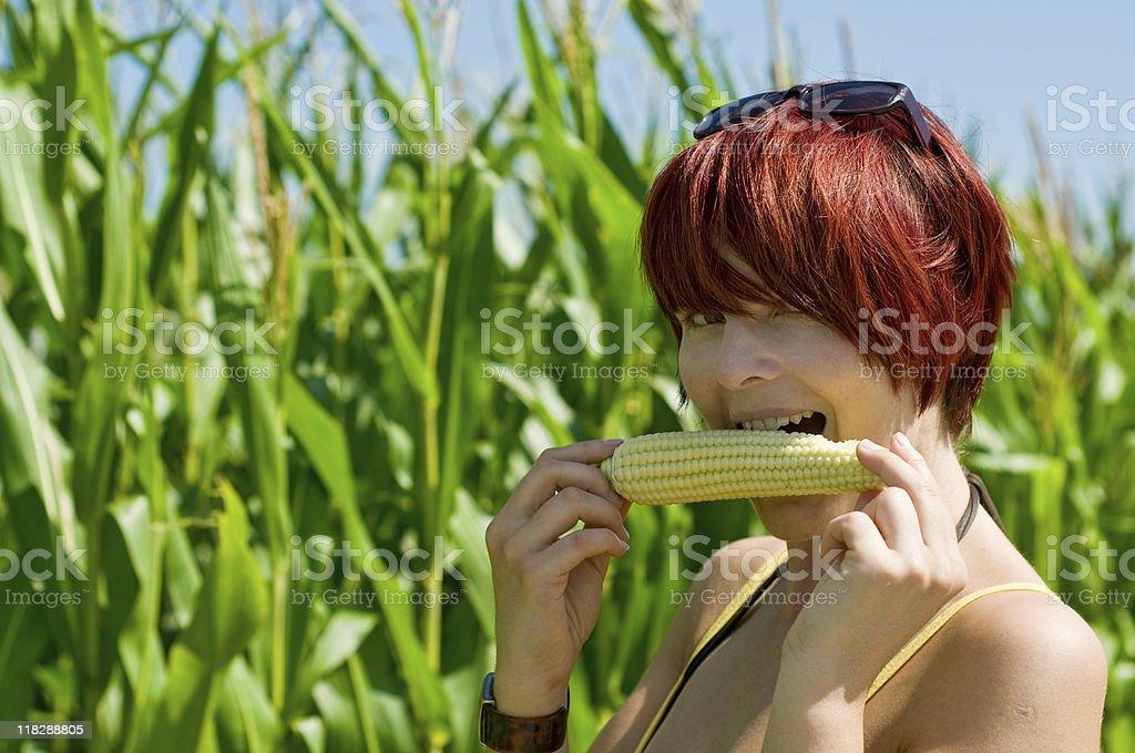 Woman eating Corncob royalty-free stock photo