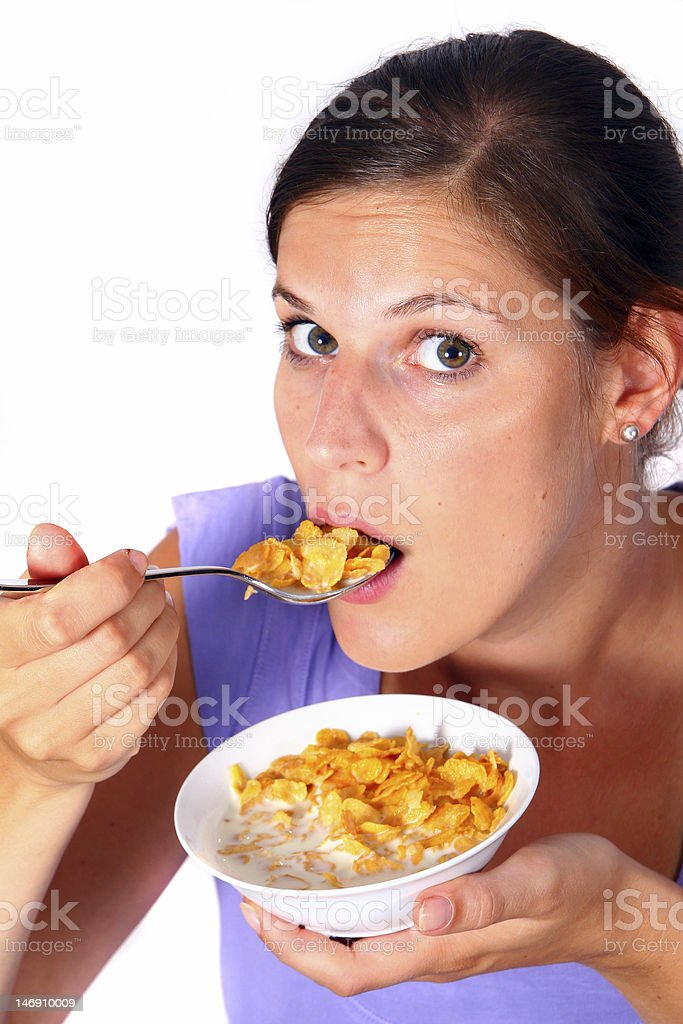 Woman eating cornflakes royalty-free stock photo