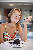 Woman eating dessert at cafe