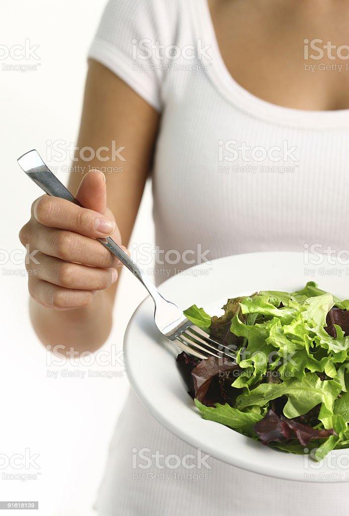 Woman eating fresh salad royalty-free stock photo