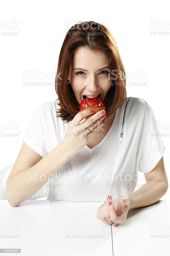 Woman eating fresh strawberry cake royalty-free stock photo
