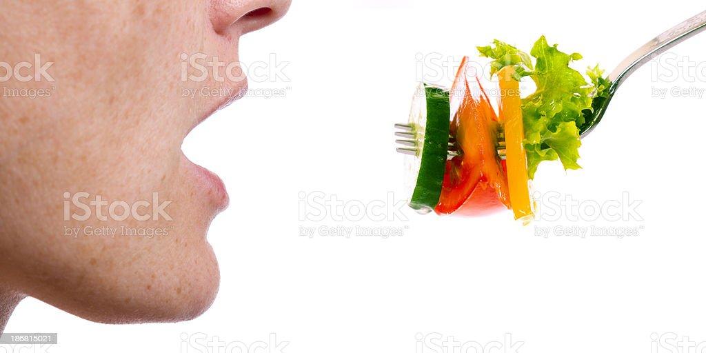 woman eating fresh vegetables royalty-free stock photo