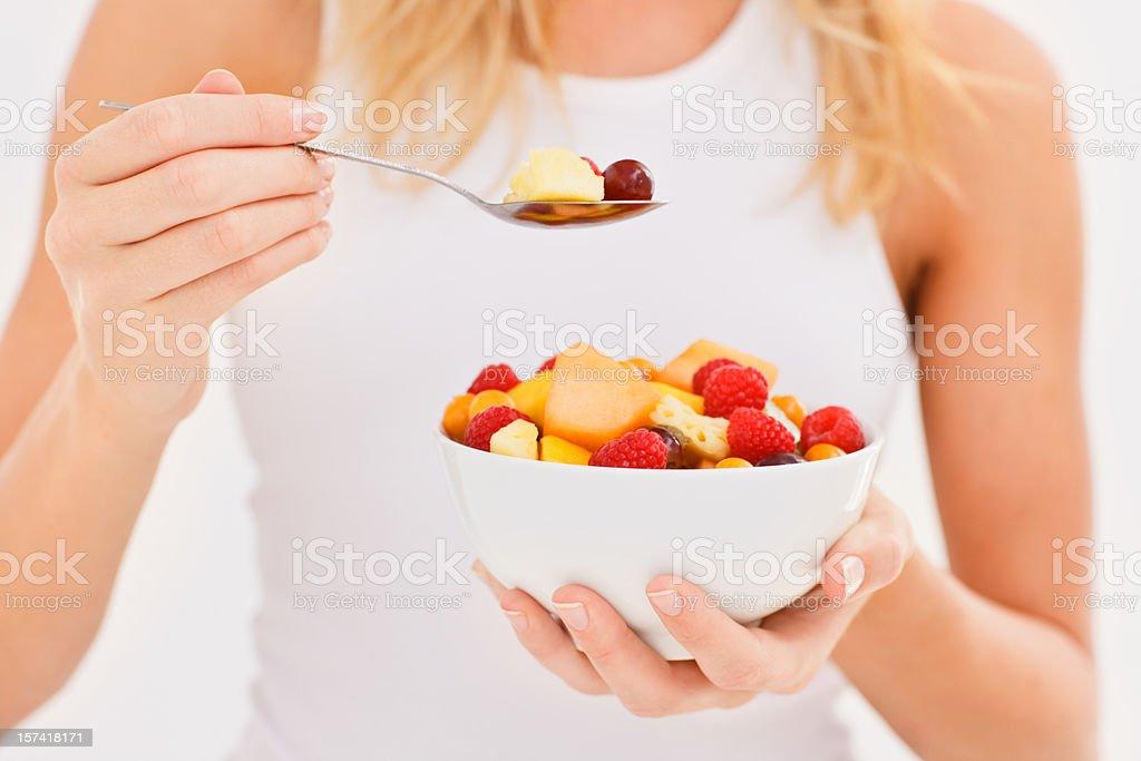 Woman eating fruit salad royalty-free stock photo