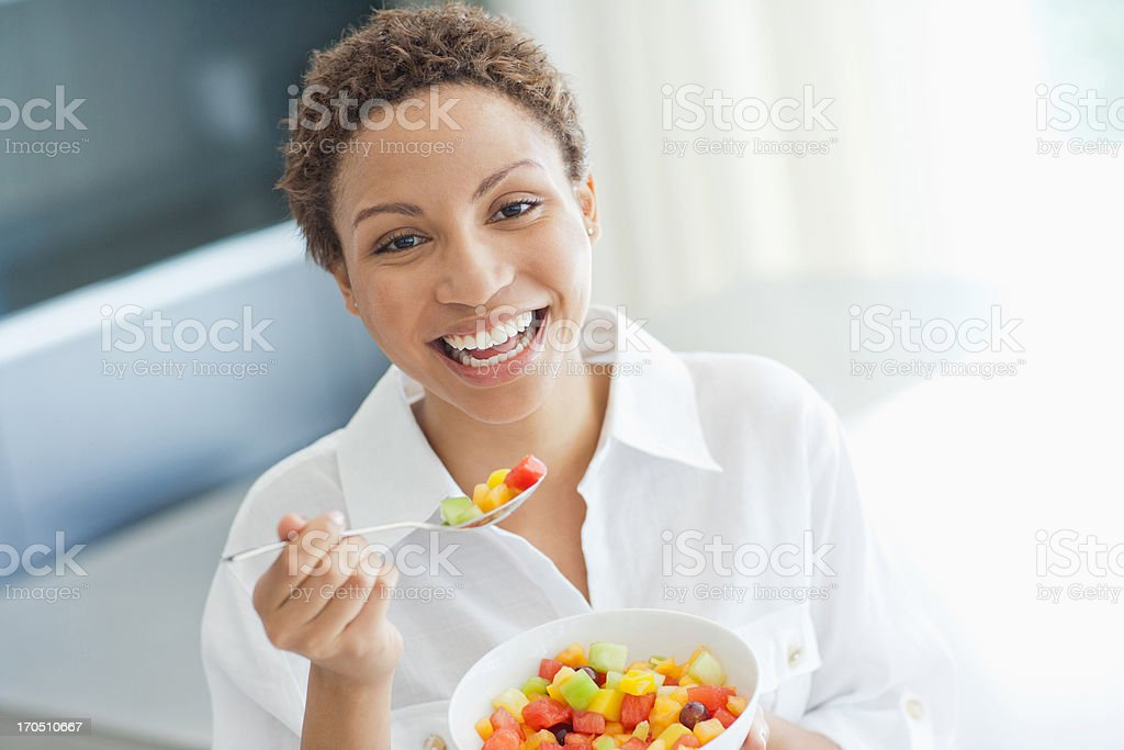 Woman eating fruit salad royalty-free stock photo