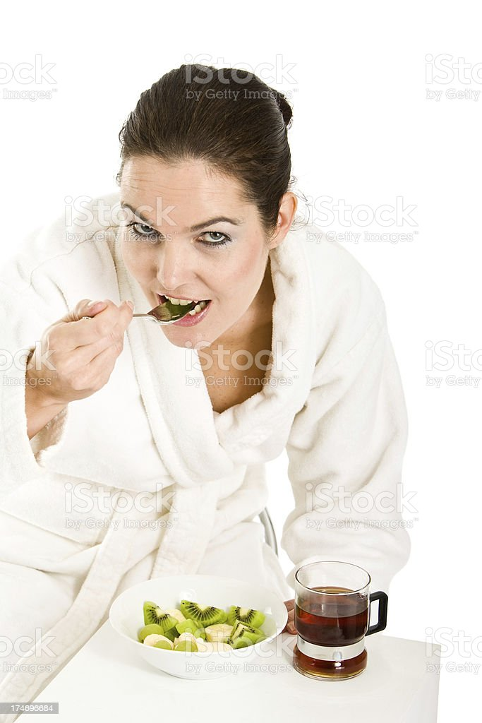 Woman eating healthy breakfast stock photo
