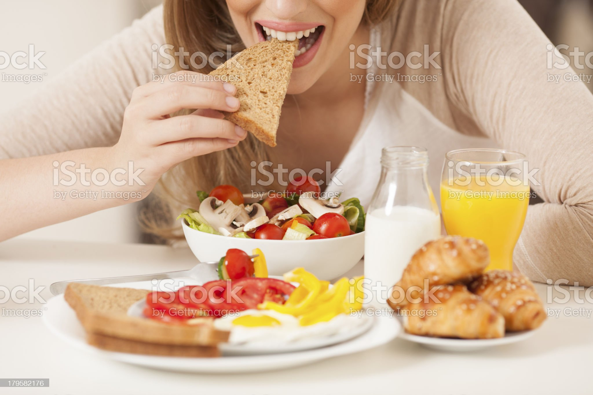 Woman eating healthy breakfast. royalty-free stock photo