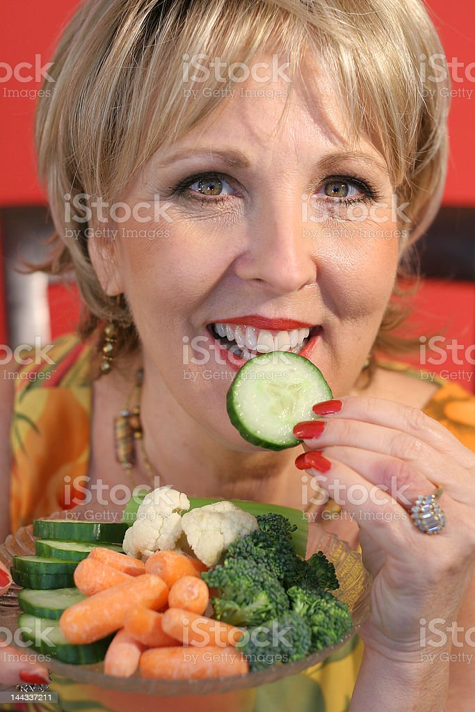 woman eating healthy food upclose vertical royalty-free stock photo