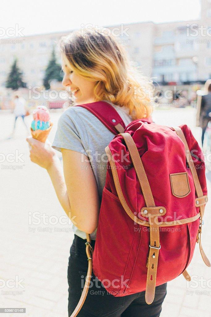 Woman eating ice-cream stock photo