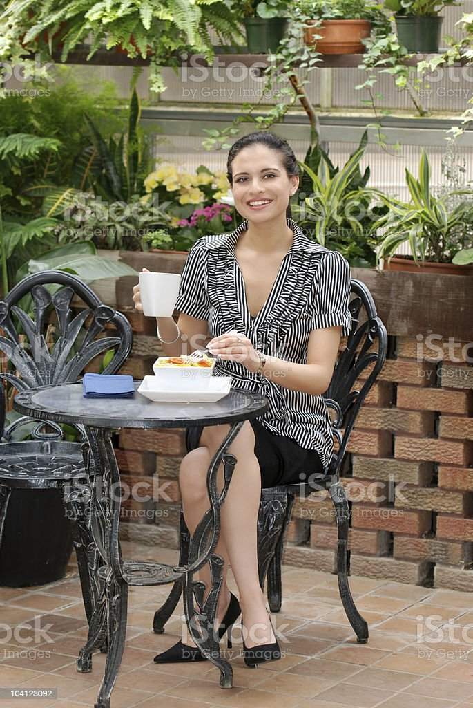 woman eating in a patio royalty-free stock photo