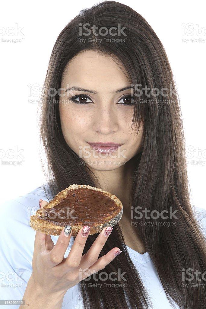 Woman Eating Marmite on Toast stock photo