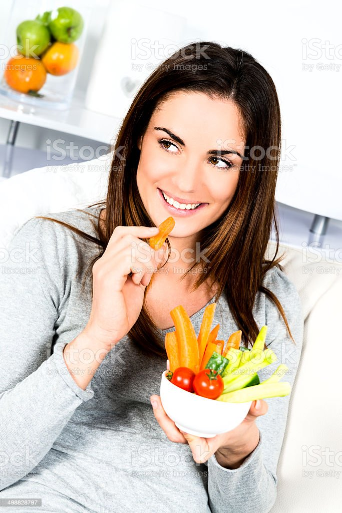 Woman eating salad. stock photo