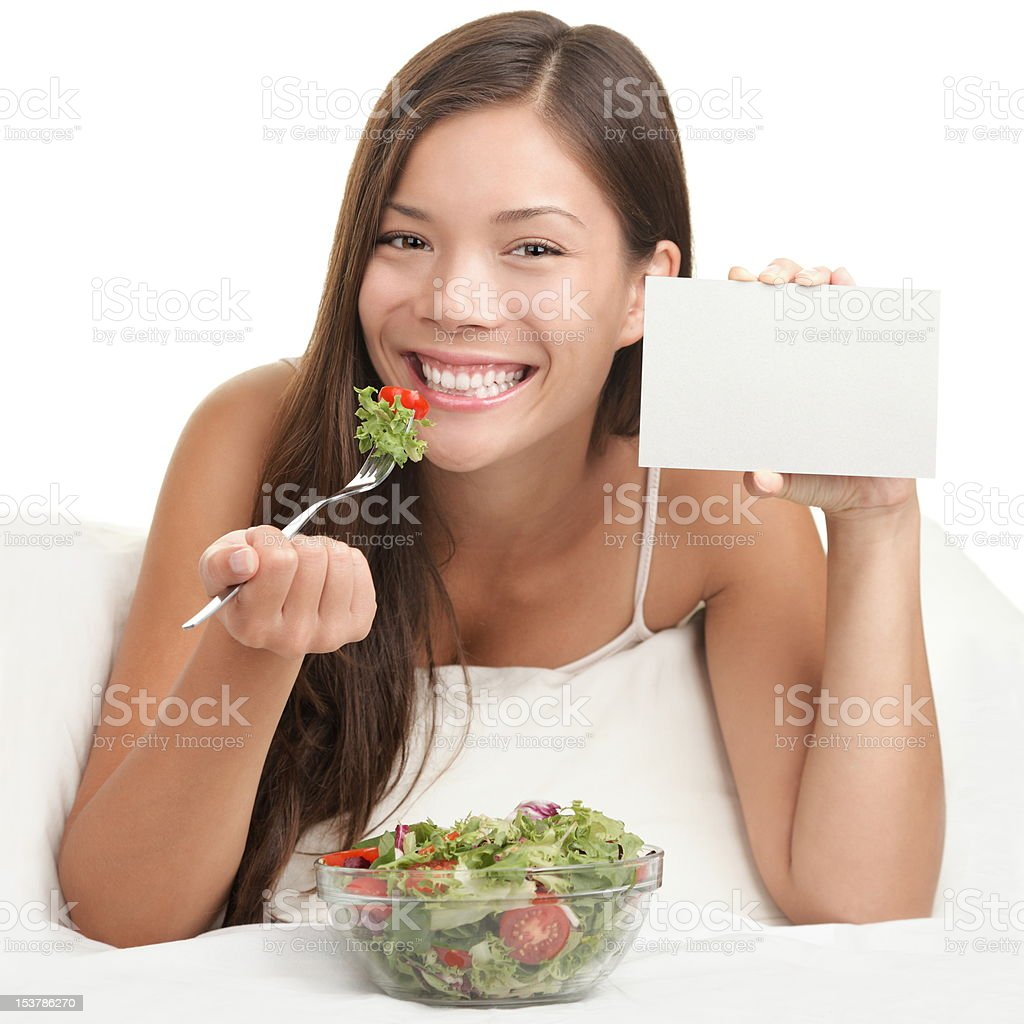 Woman Eating Salad showing copy space sign royalty-free stock photo