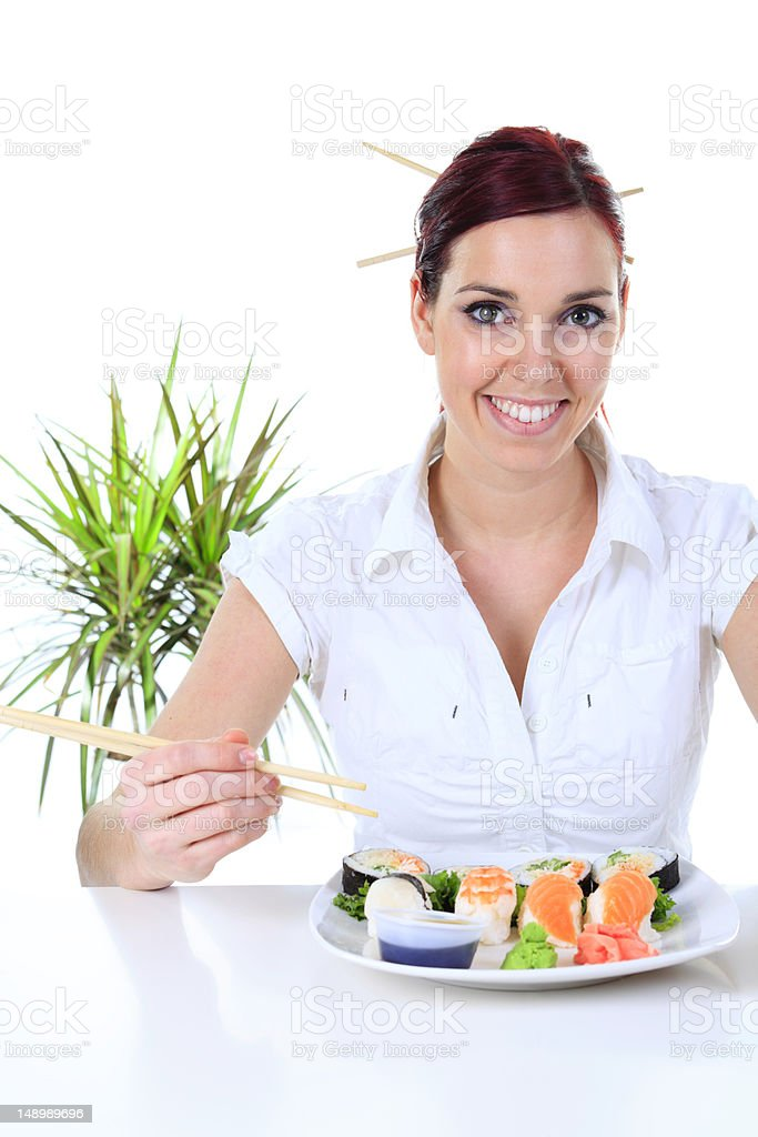 Woman Eating Sushi royalty-free stock photo