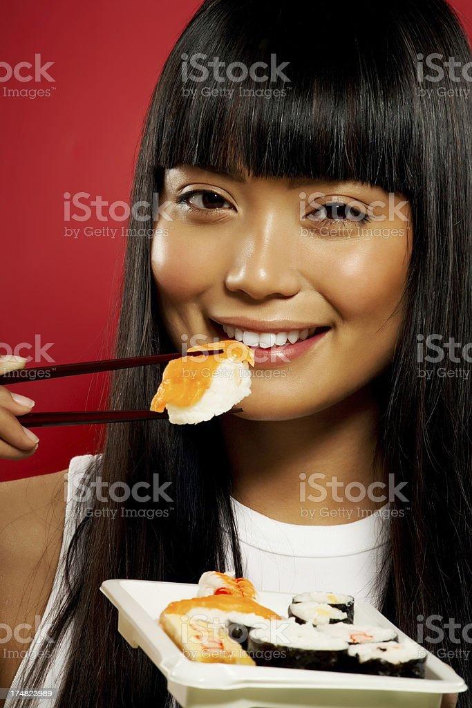 Woman Eating Sushi stock photo
