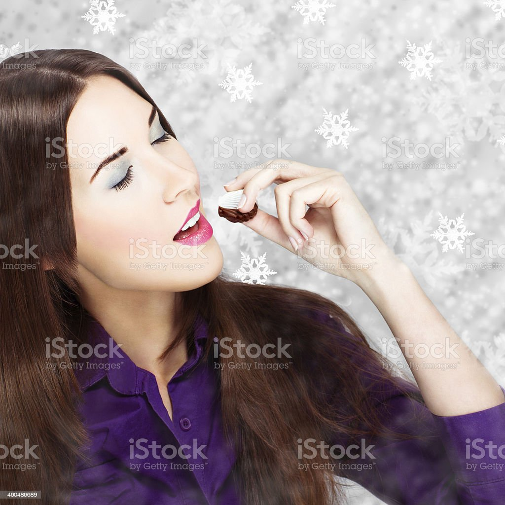 Woman eating sweets at winter royalty-free stock photo