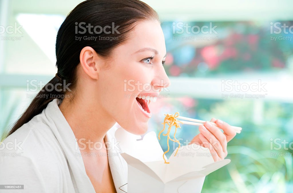 Woman eating takeout royalty-free stock photo