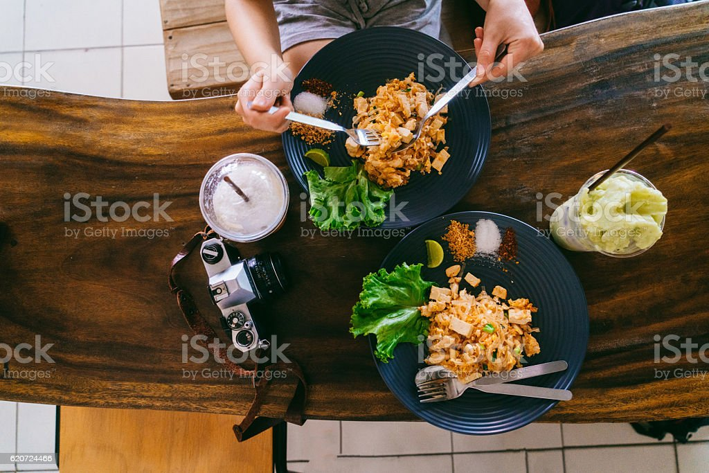 Woman eating Thai food Pad Thai stock photo