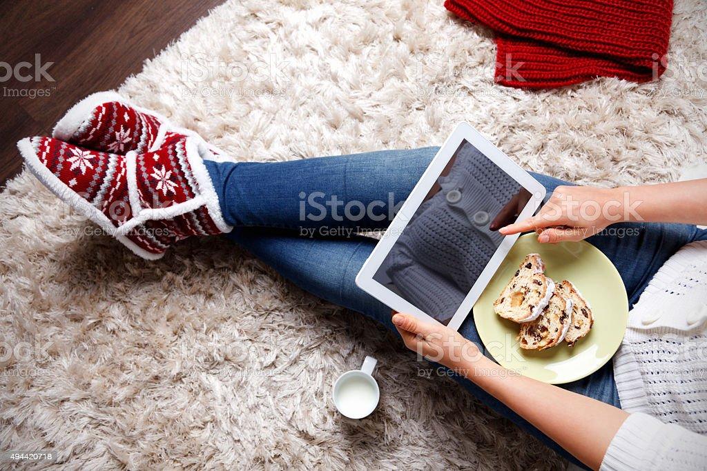 Woman eating traditional christmas cookie stock photo