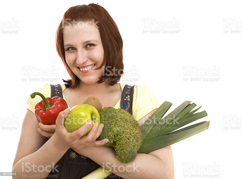 Woman eating vegetables royalty-free stock photo
