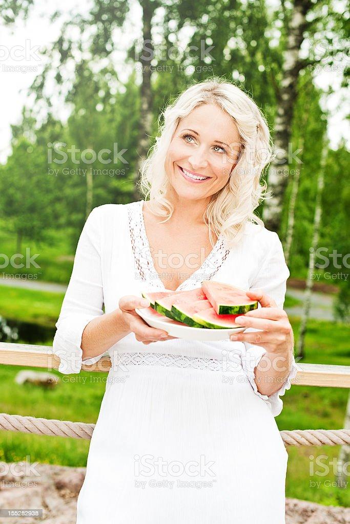 woman eating watermelon royalty-free stock photo