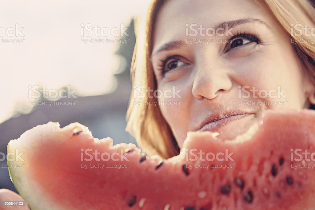 Woman Eating Watermelon stock photo