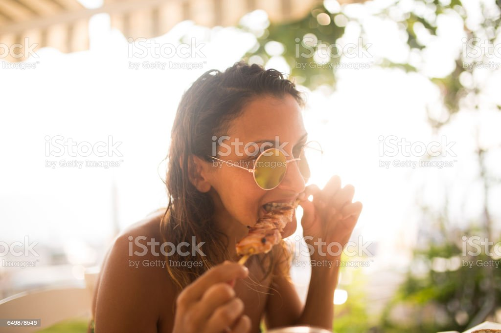 Woman Eating with hands stock photo