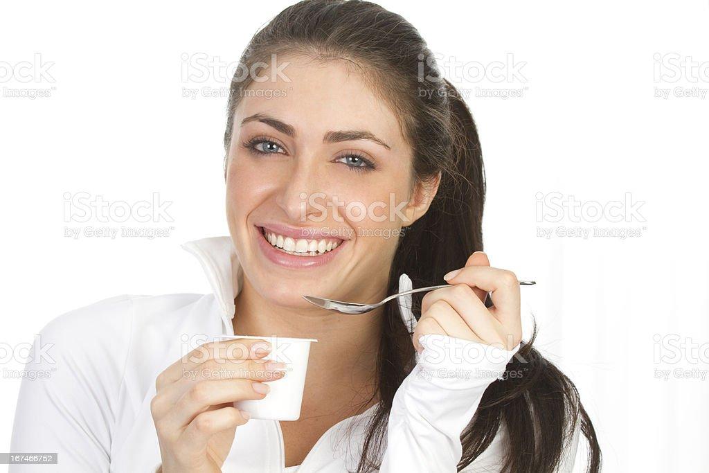 woman eating yogurt royalty-free stock photo