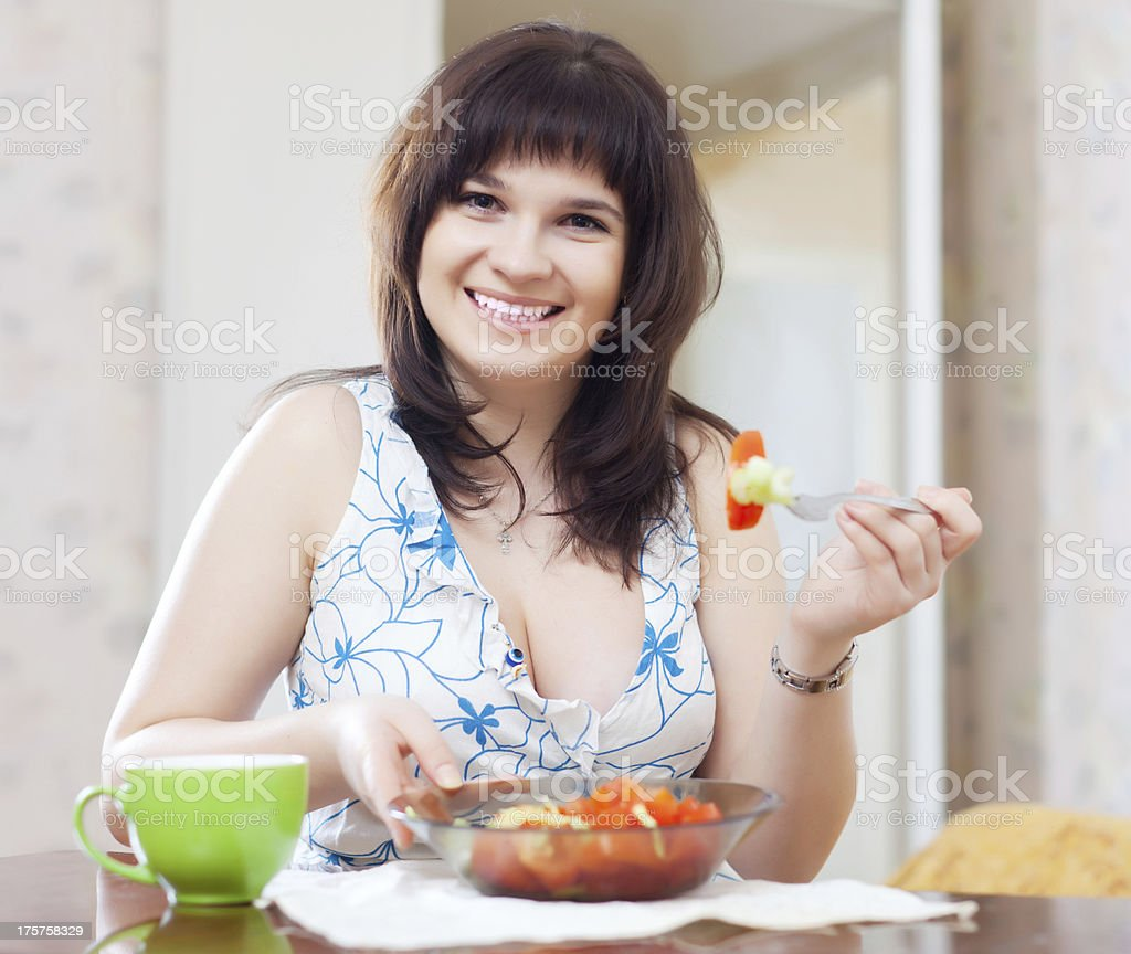 woman eats vegetables royalty-free stock photo