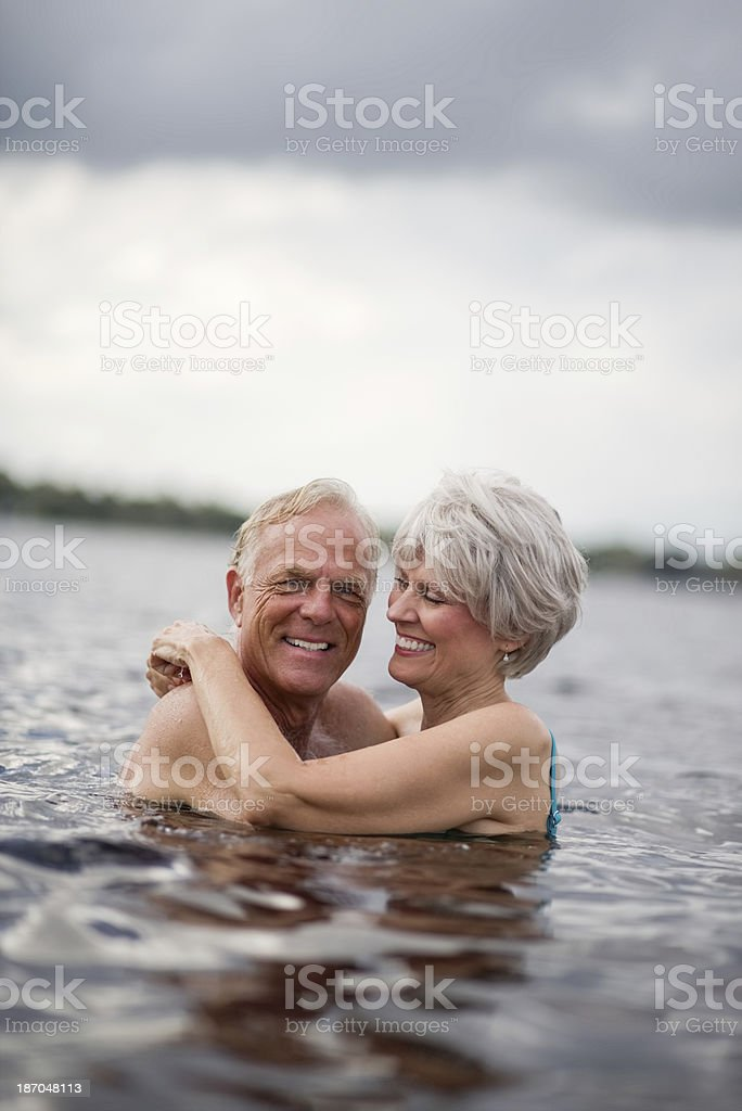 Woman Embracing Her Husband In Sea royalty-free stock photo