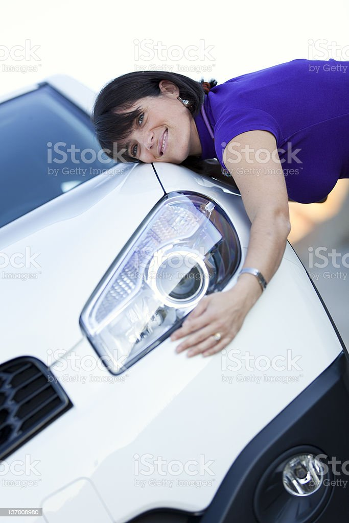 Woman embracing her new car royalty-free stock photo