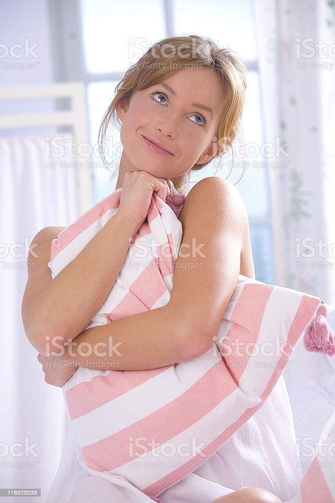 Woman embracing pillow stock photo